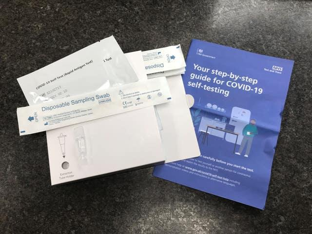 A package of seven NHS Test and Trace COVID-19 self-testing kits (Rapid Antigen Test) which has been received through the mail after ordering online for use at home