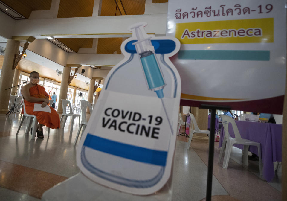 A Buddhist monk waits to receive a dose of the Astrazeneca COVID-19 vaccine at Nak Prok Temple in Bangkok, Thailand, Friday, April 9, 2021. (AP Photo/Sakchai Lalit)