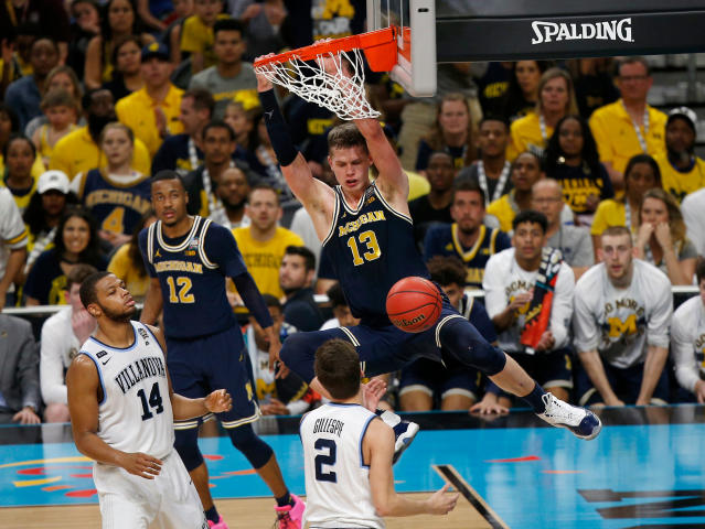 Michigan's Moritz Wagner (13) dunks during the second half in the championship game of the Final Four NCAA college basketball tournament against Villanova, Monday, April 2, 2018, in San Antonio. (AP Photo/Brynn Anderson)