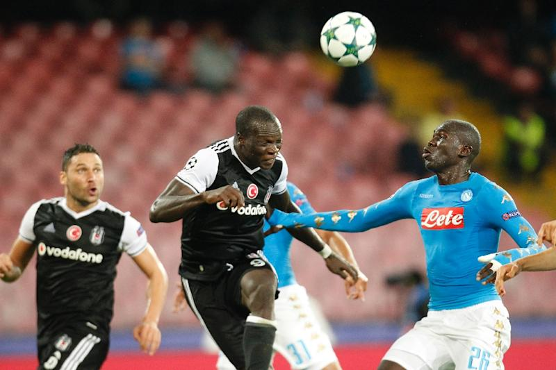 Besiktas' Vincent Aboubakar (C) scores in front of Napoli's Kalidou Koulibaly during their UEFA Champions League Group B match, in Naples, on October 19, 2016