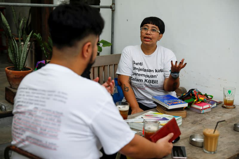 Indonesian artist Ika Vantianti talks with her colleague Yolando Zelkeos Siahaya at a cafe in Jakarta