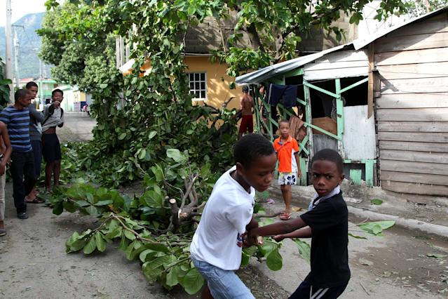 <p>Children remove fallen tree branches in the aftermath of Hurricane Irma in Puerto Plata, Dominican Republic, Sept. 8, 2017. (Photo: Ricardo Rojas/Reuters) </p>