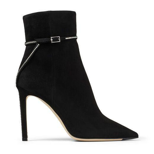 """<p><strong>Jimmy Choo</strong></p><p>jimmychoo.com</p><p><strong>$1095.00</strong></p><p><a href=""""https://go.redirectingat.com?id=74968X1596630&url=https%3A%2F%2Fus.jimmychoo.com%2Fen%2Fwomen%2Fshoes%2Fboots%2Fleille-100%2Fblack-suede-ankle-boots-with-crystal-trim-LEILLE100DCC000757.html%3Fcgid%3Dwomen-shoes-boots%23start%3D1&sref=https%3A%2F%2Fwww.harpersbazaar.com%2Ffashion%2Ftrends%2Fg7958%2Fhow-to-wear-ankle-boots%2F"""" rel=""""nofollow noopener"""" target=""""_blank"""" data-ylk=""""slk:Shop Now"""" class=""""link rapid-noclick-resp"""">Shop Now</a></p><p>A higher ankle boot can be easier to style with pants and midi-length dresses. </p>"""