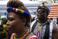 People wait to perform during a free outdoor event organized by The Broadway League during Juneteenth celebrations at Times Square on Saturday, June 19, 2021, in New York. Parades, picnics and lessons in history marked Juneteenth celebrations in the U.S., a day that marks the arrival of news to enslaved Black people in a Texas town that the Confederacy had surrendered in 1865 and they were free. (AP Photo/Eduardo Munoz Alvarez)