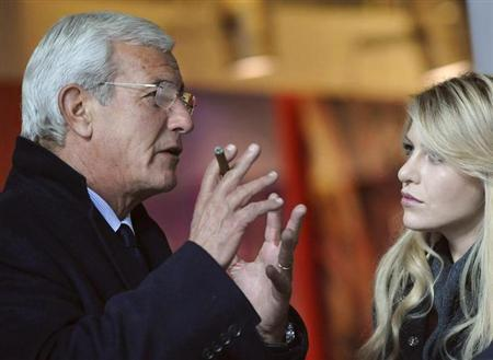 Italian coach Marcello Lippi (L) talks with Barbara Berlusconi, the daughter of Italian Prime Minister Silvio Berlusconi, before of the Italian Serie A soccer match between AC Milan and Palermo at San Siro stadium in Milan November 10, 2010. REUTERS/Giorgio Perottino