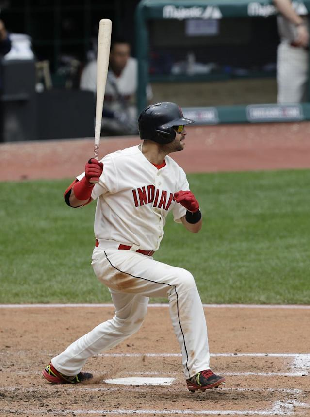 Cleveland Indians' Nick Swisher hits a single off Texas Rangers starting pitcher Alexi Ogando in the fifth inning of a baseball game, Sunday, July 28, 2013, in Cleveland. (AP Photo/Tony Dejak)