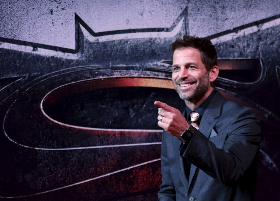 Director Zack Snyder poses as he arrives on the red carpet for the screening of the movie