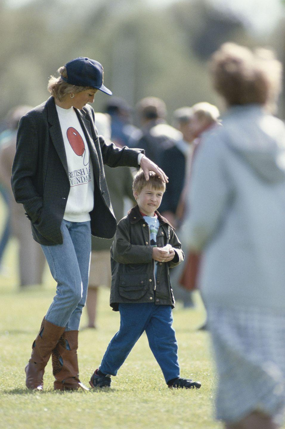 <p>Later that same month, the Princess of Wales dresses casually to attend a polo match at the Guards Polo Club in Windsor with Prince William. Diana's sweatshirt features the British Lung Foundation logo on the front.</p>