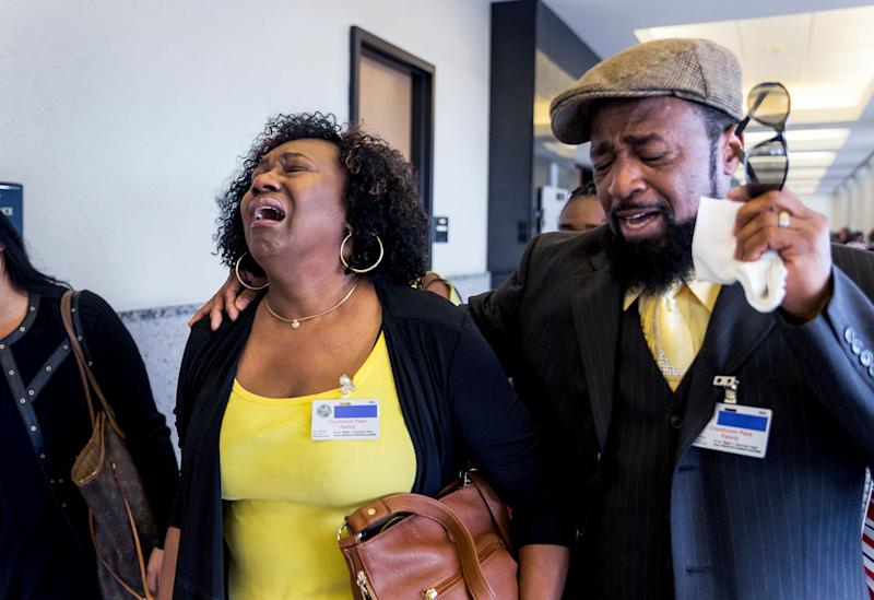 Kattie Jones and her husband, Clinton Jones, Sr., father of Corey Jones, walk down the hall from the courtroom after Nouman Raja was found guilty Thursday, March 7, 2019 in West Palm Beach. Raja, 41, faces a mandatory minimum of 25 years at sentencing April 26, and could spend his life in prison for the death of Corey Jones. (Greg Lovett/Palm Beach Post via AP, Pool)