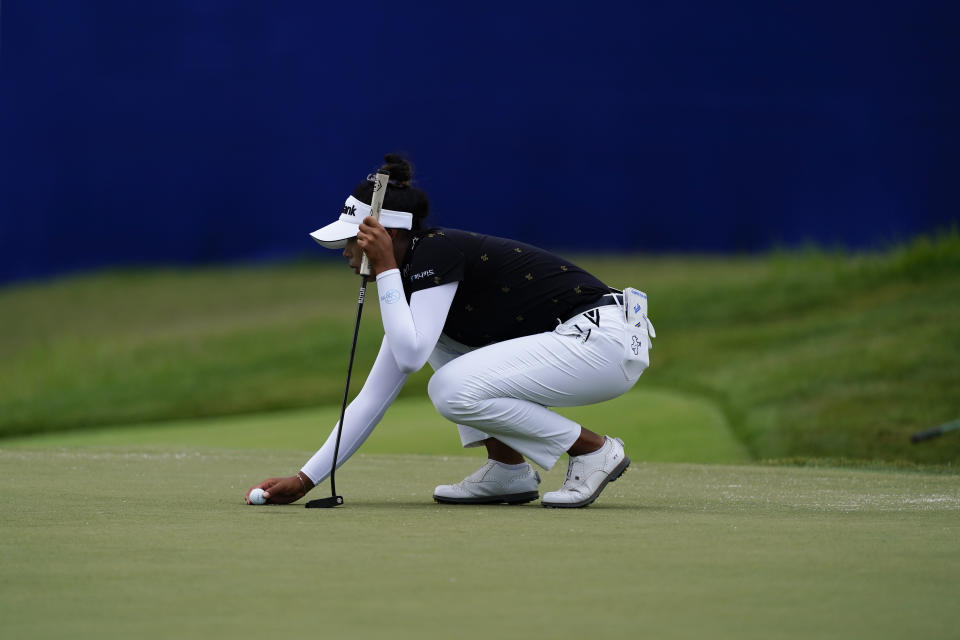 Patty Tavatanakit of Thailand lines up her putt on the 18th hole, during the third round of play in the KPMG Women's PGA Championship golf tournament Saturday, June 26, 2021, in Johns Creek, Ga. (AP Photo/John Bazemore)