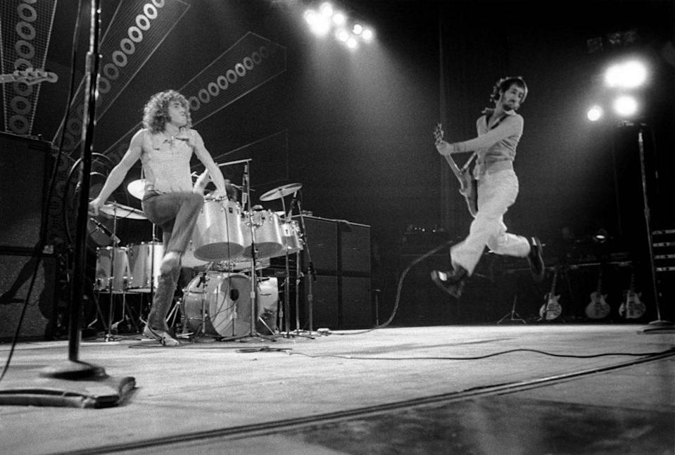 From left, Roger Daltrey and Pete Townshend (leaping in the air) of rock group The Who perform live on stage at The Lyceum in London during the Quadrophenia tour on 11th November 1973. The group would play three nights at the venue from 11th to 13th November 1973. (Photo by David Redfern/Redferns)