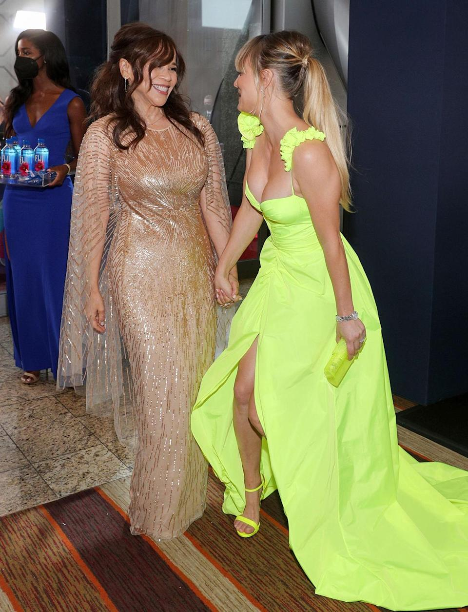 <p>Now <em>that's</em> an upgrade from the costume skirt suits! <em>The Flight Attendant</em> costars (and nominees) Rosie Perez and Kaley Cuoco giggled while making their way into the big event, holding hands.</p>