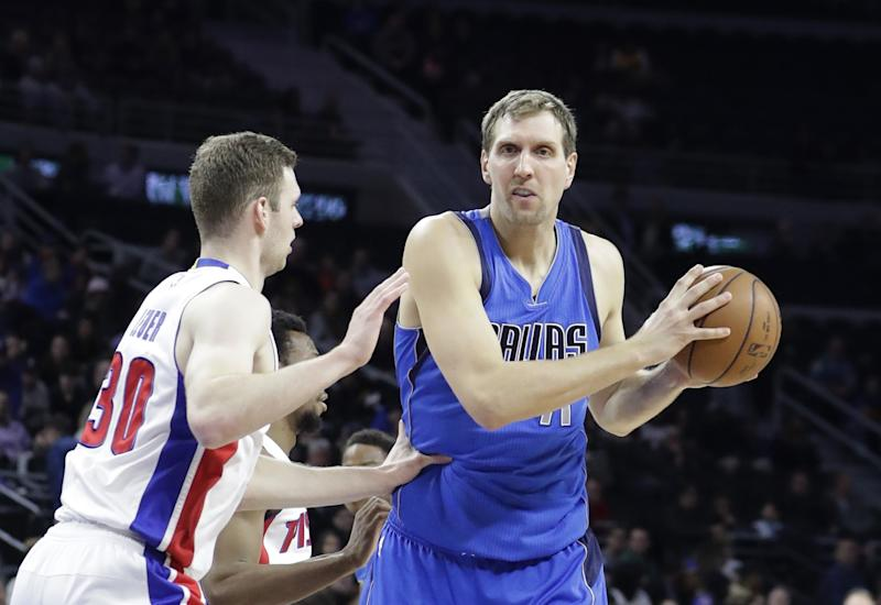 Jon Leuer defends Dirk Nowitzki during a game in February. (AP)