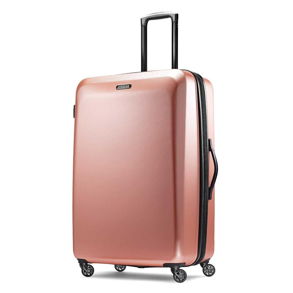 """<h2>American Tourister Moonlight Hardside Expandable Luggage</h2><br><strong>The Type: </strong>Extra-large suitcase<br><br><strong>The Hype:</strong> 4.7 out of 5 stars and 5,863 rating on Amazon<br><br><strong>What Travelers Say: </strong>""""Fantastic suitcase. I've had it for over a year and used it multiple times including travel via airplane. You can't see scratches on it, I think the pattern hides the scratches. Very easy to maneuver and very light weight. 10/10 recommend."""" – <em>Chelsey, Amazon reviewer</em><br><br><em>Shop</em> <strong><em><a href=""""https://amzn.to/3hu18eI"""" rel=""""nofollow noopener"""" target=""""_blank"""" data-ylk=""""slk:AMERICAN TOURISTER"""" class=""""link rapid-noclick-resp"""">AMERICAN TOURISTER</a></em></strong><br><br><br><strong>American Tourister</strong> Moonlight Hardside Expandable Luggage, $, available at <a href=""""https://amzn.to/2QqpQl7"""" rel=""""nofollow noopener"""" target=""""_blank"""" data-ylk=""""slk:Amazon"""" class=""""link rapid-noclick-resp"""">Amazon</a>"""