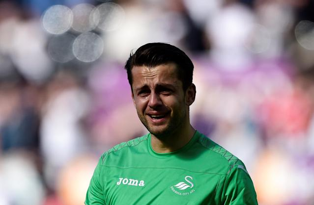 "Soccer Football - Premier League - Swansea City vs Stoke City - Liberty Stadium, Swansea, Britain - May 13, 2018 Swansea City's Lukasz Fabianski reacts after the match as they are relegated from the Premier League REUTERS/Rebecca Naden EDITORIAL USE ONLY. No use with unauthorized audio, video, data, fixture lists, club/league logos or ""live"" services. Online in-match use limited to 75 images, no video emulation. No use in betting, games or single club/league/player publications. Please contact your account representative for further details."