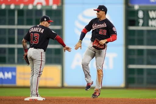 Washington Nationals' Juan Soto and Asdrubal Cabrera celebrate after Game 2 of the baseball World Series against the Houston Astros Thursday, Oct. 24, 2019, in Houston. The Nationals won 12-3 to take a 2-0 lead in the series. (AP Photo/David J. Phillip)