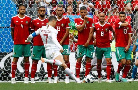 Portugal's Cristiano Ronaldo shoots at goal from a free kick. REUTERS/Kai Pfaffenbach