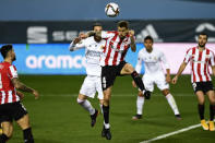 Athletic Bilbao's Inigo Martinez, top front, goes for a header with Real Madrid's Sergio Ramos during Spanish Super Cup semi final soccer match between Real Madrid and Athletic Bilbao at La Rosaleda stadium in Malaga, Spain, Thursday, Jan. 14, 2021. (AP Photo/Jose Breton)