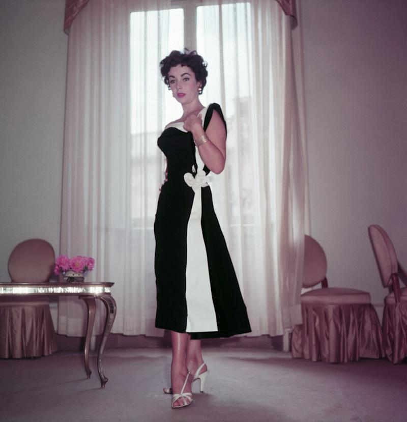 The actress wears a black and white cocktail dress in Italy in 1953.