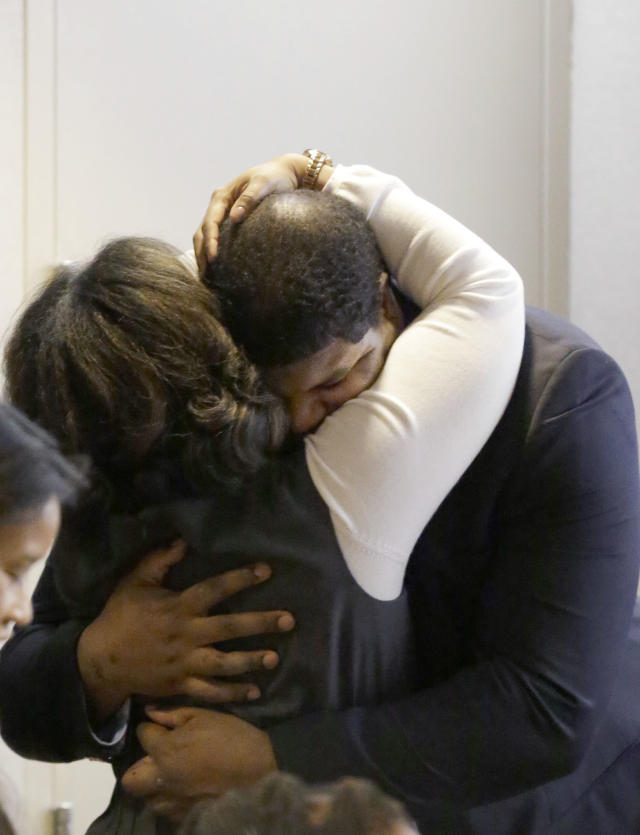 Former Dallas Cowboys NFL football player Josh Brent gets a hug from family after closing arguments in his intoxication manslaughter trial Tuesday, Jan. 21, 2014, in Dallas. The jury has begun deliberating in Brent's intoxication manslaughter trial after lawyers wrapped up their closing arguments Tuesday morning. Prosecutors accuse the former defensive tackle of drunkenly crashing his Mercedes near Dallas during a night out in December 2012, killing his good friend and teammate, Jerry Brown. (AP Photo/LM Otero)