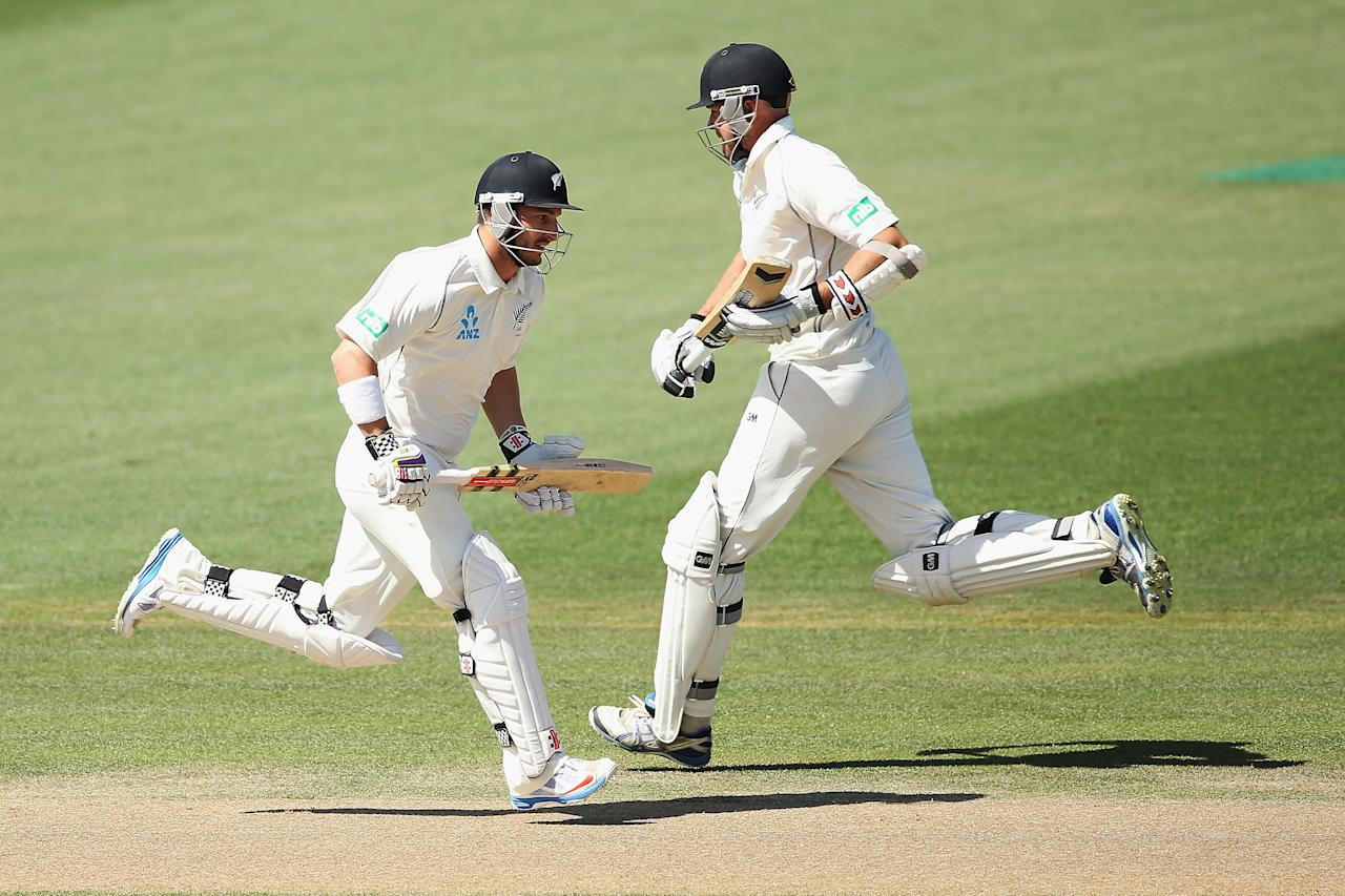 HAMILTON, NEW ZEALAND - DECEMBER 22:  Hamish Rutherford and Peter Fulton of New Zealand take a single during day four of the Third Test match between New Zealand and the West Indies at Seddon Park on December 22, 2013 in Hamilton, New Zealand.  (Photo by Hannah Johnston/Getty Images)