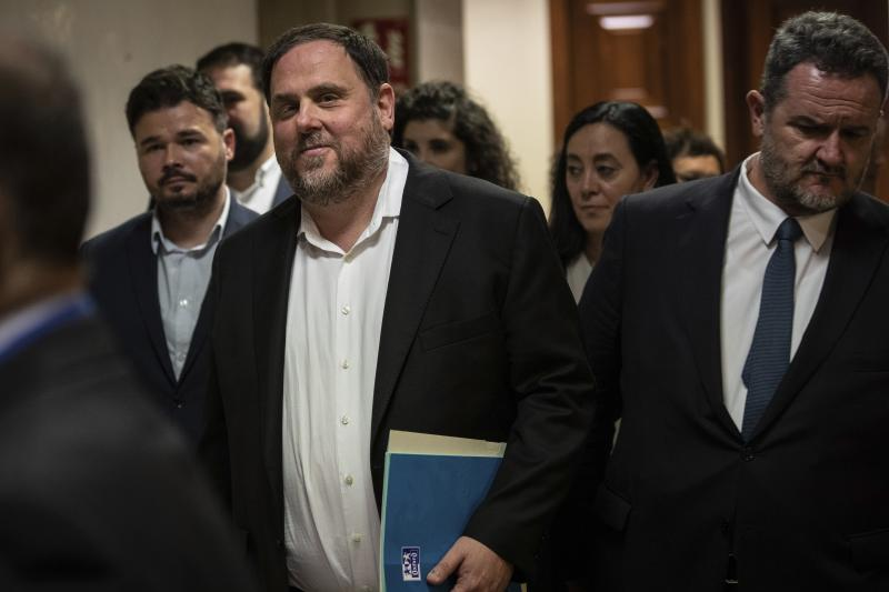 The leader of the Catalonian ERC party Oriol Junqueras, centre, leaves after collecting his credentials at the Spanish parliament in Madrid, Spain, Monday, May 20, 2019. Junqueras and three other high-profile separatists won seats in the Lower Chamber, while Raul Romeva won a seat in the Senate. The five, along with other defendants, are being held in pre-trial jail. They face several years in prison if found guilty of rebellion. (AP Photo/Bernat Armangue)