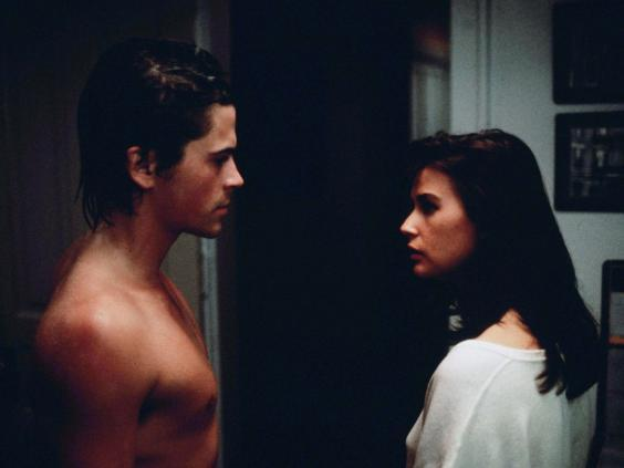 Chicago yuppies Dan (Rob Lowe) and Debbie (Demi Moore) can't help coming back for more (Rex)