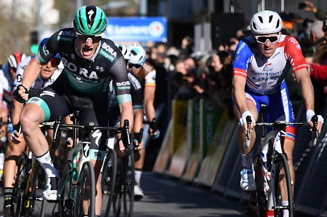 Sam Bennett celebrates as he crosses the finish line ahead of Arnaud Demare (AFP Photo/Anne-Christine POUJOULAT)
