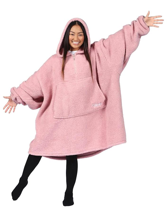 """<p>If an oversized, fluffy, sherpa hoodie doesn't scream """"treat yourself,"""" we don't know what does. The Comfy is a wearable blanket that takes comfort to the next level, and their new Teddy Bear quarter-zip is their coziest version yet. Say hello to your new work from home 'fit! </p> <p>Buy It! The Comfy Teddy Bear Quarter-Zip, $49.99; <a href=""""https://thecomfy.com/products/the-comfy-teddy-bear-quarter-zip?variant=36036933353628"""" rel=""""sponsored noopener"""" target=""""_blank"""" data-ylk=""""slk:thecomfy.com"""" class=""""link rapid-noclick-resp"""">thecomfy.com</a></p>"""