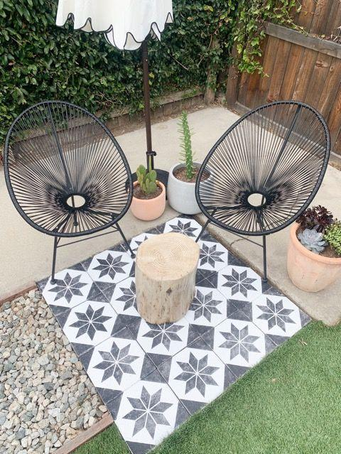 """<p>Bowman used a stencil and paint to add the accent flooring to this backyard revamp, in addition to lovely ceramic pots. </p><p>If you're thinking of doing something similar, <a href=""""https://www.instagram.com/bowhousedesign/"""" rel=""""nofollow noopener"""" target=""""_blank"""" data-ylk=""""slk:Bowman"""" class=""""link rapid-noclick-resp"""">Bowman</a> says to just go for it. """"No one feels super confident when trying something new, but you just learn as you go,"""" she tells Woman's Day. """"This is the perfect beginner DIY because at the end of the day it's just paint, if it doesn't come out the way you hoped it would you can paint over it and try again.""""</p><p><strong>Suggested Products</strong>: <a href=""""https://www.royaldesignstudio.com/collections/tile-stencils/products/star-quilt-tile-stencil?variant=9273304842292"""" rel=""""nofollow noopener"""" target=""""_blank"""" data-ylk=""""slk:""""Star Quilt"""" tile stencil"""" class=""""link rapid-noclick-resp"""">""""Star Quilt"""" tile stencil </a>($20 for 12"""" x 12"""" tile, Royal Design Studio Stencils); <a href=""""https://www.overstock.com/Home-Garden/Sarcelles-Modern-Wicker-Patio-Chairs-by-Corvus-Set-of-2/17805643/product.html?option=50957285"""" rel=""""nofollow noopener"""" target=""""_blank"""" data-ylk=""""slk:Acapulco weave chairs"""" class=""""link rapid-noclick-resp"""">Acapulco weave chairs</a> ($173, Overstock)</p>"""