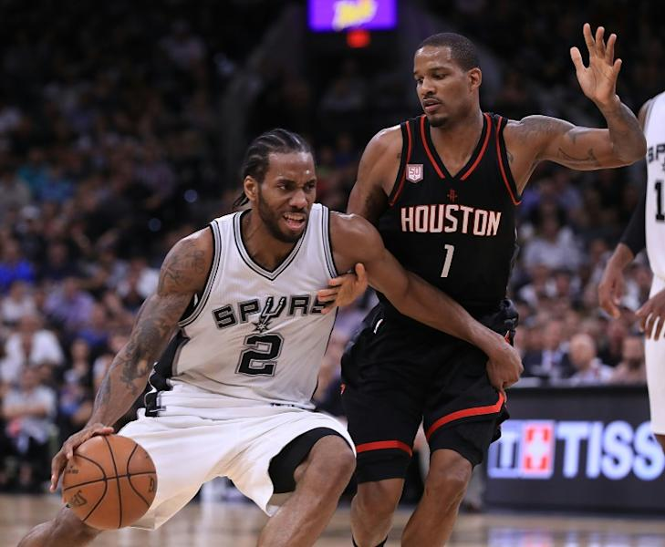 Kawhi Leonard of the San Antonio Spurs drives against Trevor Ariza of the Houston Rockets in Game Two of the NBA Western Conference semi-finals, at AT&T Center in San Antonio, Texas, on May 3, 2017