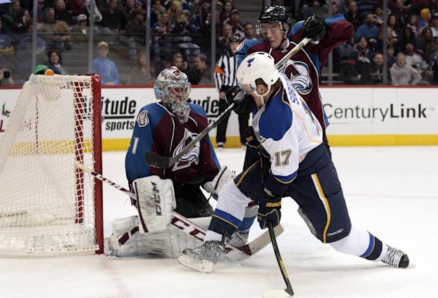 St. Louis Blues center Vladimir Sobotka (17) drives to the net against Colorado Avalanche defenseman Tyson Barrie (4) and Avalanche goalie Semyon Varlamov (1) during the second period of an NHL hockey game in Denver, Wednesday, Nov. 27, 2013. (AP Photo/Joe Mahoney)