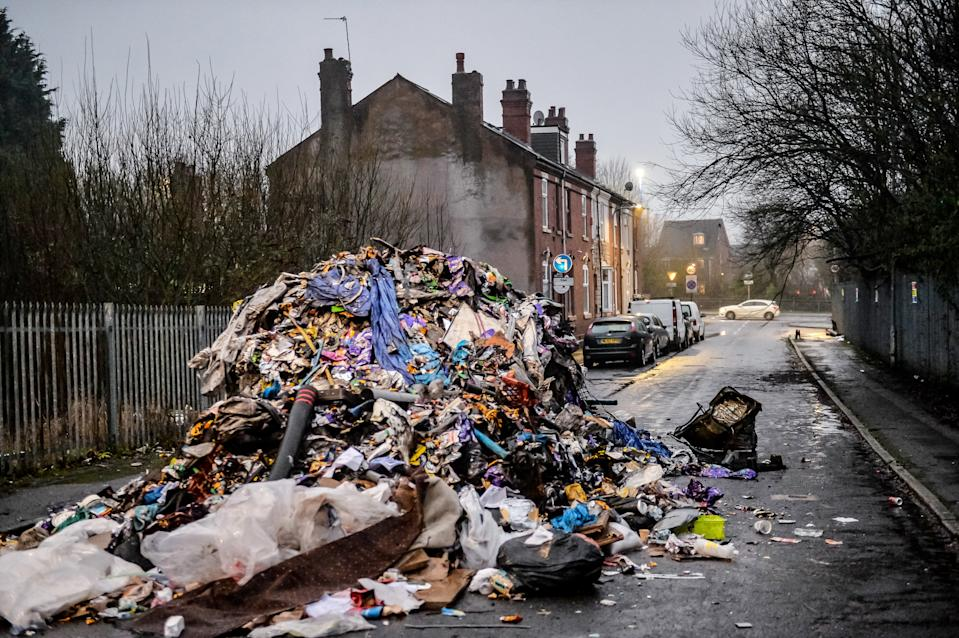 The huge pile of rubbish was dumped overnight, leaving the road impassable. (SWNS)