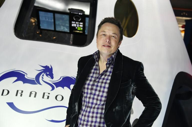 """SpaceX founder Elon Musk (pictured with the Dragon capsule in May 2014) said the company started with """"just a few people, who didn't really know how to make rockets"""""""