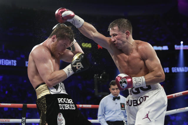 Canelo Alvarez, left, and Gennady Golovkin trade punches in the seventh round during a middleweight title boxing match, Saturday, Sept. 15, 2018, in Las Vegas. (AP Photo/Isaac Brekken)