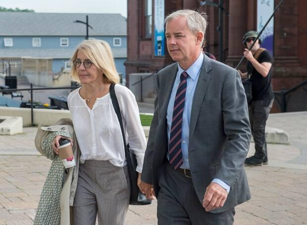 Dennis Oland and his then-wife Lisa arrive at the law courts in Saint John during his second-degree murder trial.