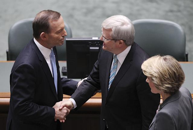 CANBERRA, AUSTRALIA - JUNE 27: Australian Prime Minister Kevin Rudd and Opposition leader Tony Abbott shake hands in the House of Representatives on June 27, 2013 in Canberra, Australia. Kevin Rudd won an Australian Labor Party leadership ballot 57-45 last night, and will be sworn in this morning as Australian Prime Minister by Governor-General Quentin Bryce. Rudd was Prime Minister from 2007 to 2010 before he was dumped by his party for his deputy Julia Gillard. Gillard has announced that she will leave parliament and not contest her seat following her ballot loss. (Photo by Stefan Postles/Getty Images)