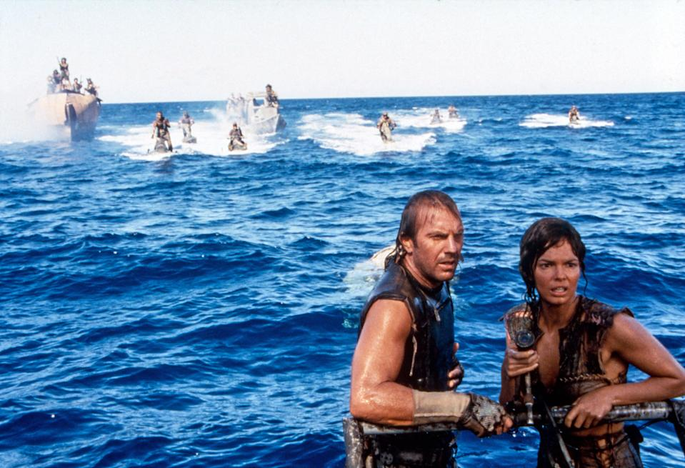 Costner and Tripplehorn in <em>Waterworld</em>. (Photo: Ben Glass/Universal Pictures/Courtesy: Everett Collection)