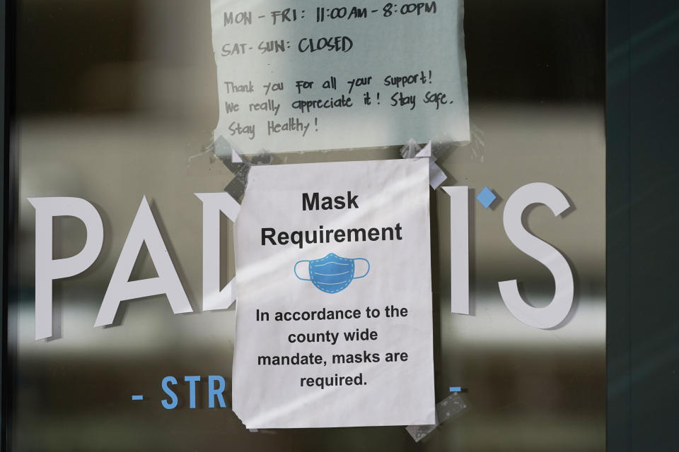 """A """"Mask Requirement"""" is shown on a door on Sept. 10, 2020, in Salt Lake City. (Rick Bowmer/AP)"""