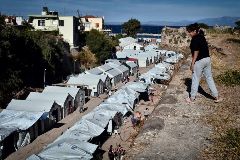 The Greek government said it would replace the overcrowded camps with new closed facilities (AFP Photo/LOUISA GOULIAMAKI)
