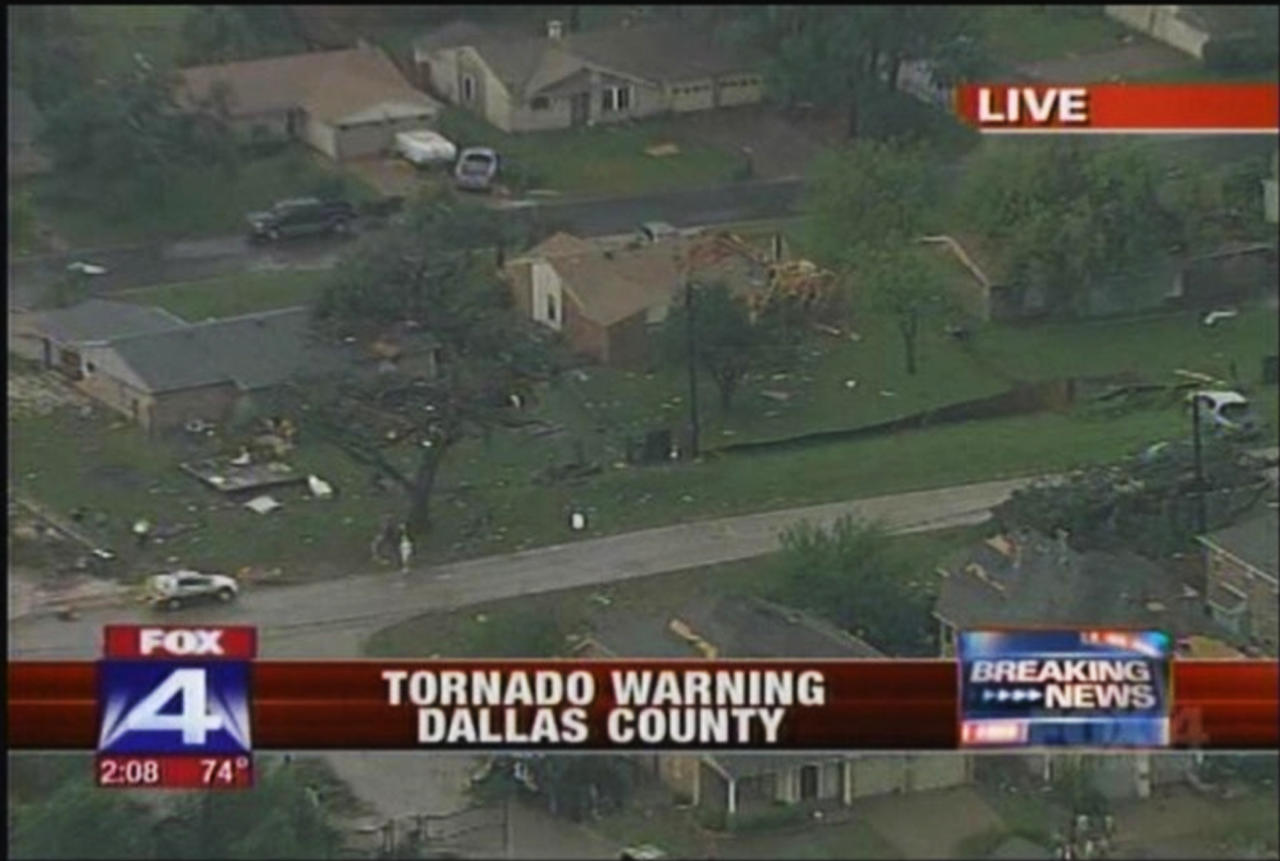 This frame grab provided by KDFW-TV shows storm damage Tuesday, March 3, 2012, in  Arlington, Texas.  Several reported tornadoes tore through the Dallas area on Tuesday, tossing semis in the air and leaving crumpled tractor trailers strewn along highways and in truck stop parking lots. (AP Photo/KDFW-TV) MANDATORY CREDIT