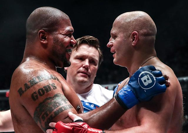 Jackson (L) embraces and smiles with fellow legend Fedor Emelianenko after being TKO'd by Emelianenko (Photo by Valery Sharifulin\TASS via Getty Images).