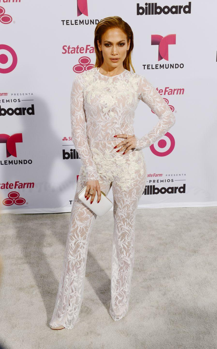 <p>In a white lace jumpsuit at the ceremony in Miami.</p>
