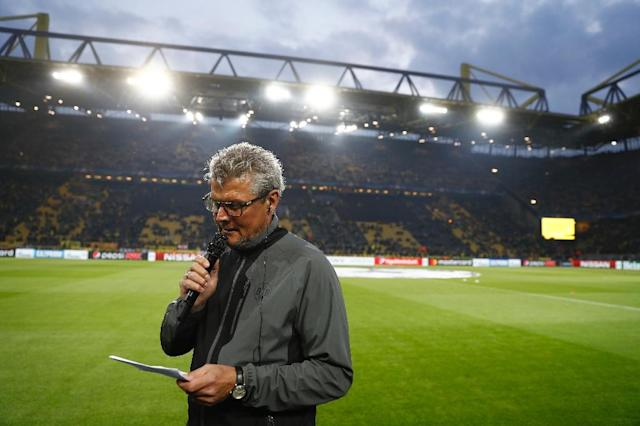 Borussia Dortmund stadium official Norbert Dickel announces the postponement of Dortmund vs Monaco Champions League, on April 11, 2017 (AFP Photo/Odd Andersen)