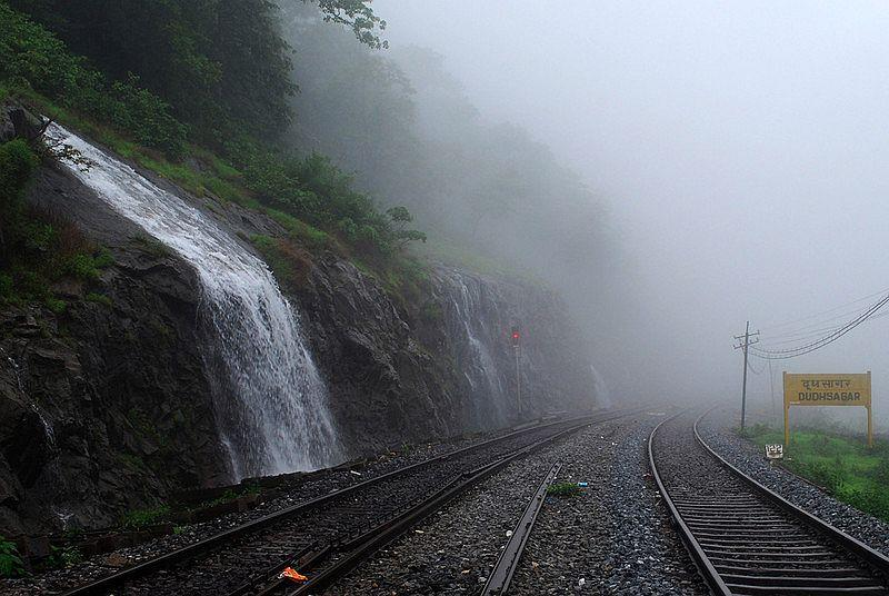 At Dudhsagar railway station, the atmosphere is electrifying. Here, mist and clouds hover. The trio continues to trek towards Dudhsagar Falls.