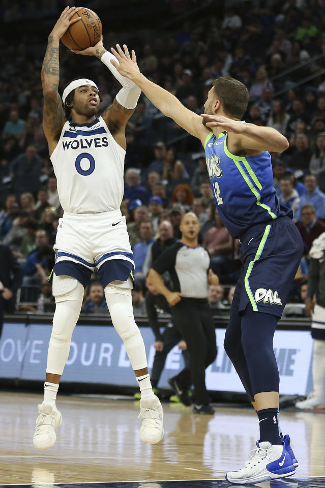 Minnesota Timberwolves' D'Angelo Russell lines up a shot against Dallas Mavericks' Maxi Kleber in the first half of an NBA basketball game Sunday, March 1, 2020, in Minneapolis. (AP Photo/Stacy Bengs)