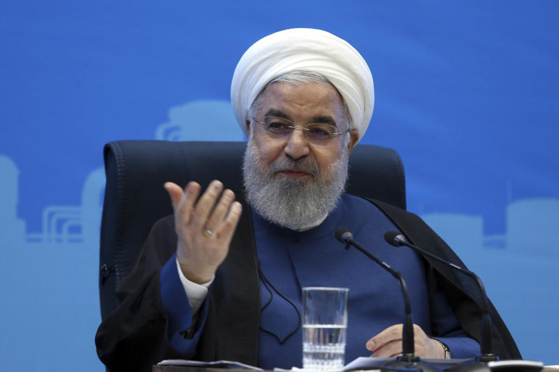 In this photo released by the official website of the office of the Iranian Presidency, President Hassan Rouhani speaks in a meeting during his provincial tour to the North Khorasan, Iran, Sunday, July 14, 2019. Rouhani said his country is ready to negotiate with the United States if Washington lifts its economic sanctions. (Iranian Presidency Office via AP)