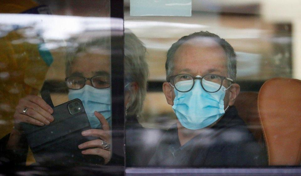 Marion Koopmans and Peter Ben Embarek on the bus as they leave the quarantine hotel in Wuhan. Photo: Reuters