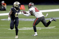 Tampa Bay Buccaneers inside linebacker Devin White, right, intercepts a pass in front of New Orleans Saints running back Alvin Kamara (41) during the second half of an NFL divisional round playoff football game, Sunday, Jan. 17, 2021, in New Orleans. (AP Photo/Brett Duke)