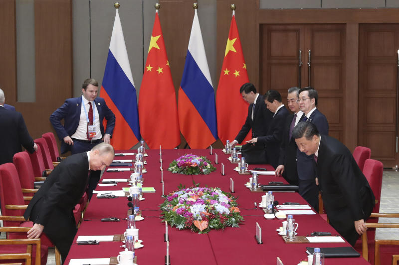 Russian President Vladimir Putin, left, and Chinese President Xi Jinping, right, attend the meeting in Beijing Friday, April 26, 2019. (Kenzaburo Fukuhara/Pool Photo via AP)